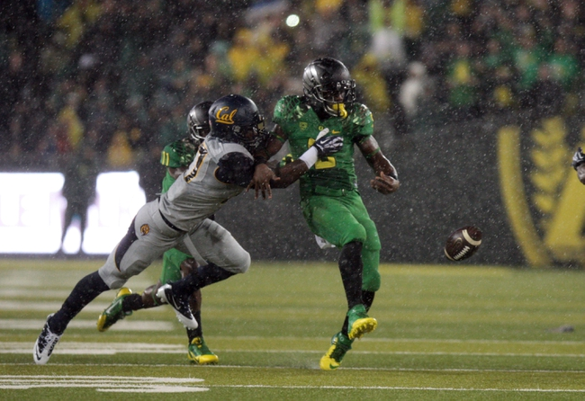 Sep 28, 2013; Eugene, OR, USA; Oregon Ducks running back Byron Marshall (9) fumbles the ball in the first quarter against the California Golden Bears at Autzen Stadium. Mandatory Credit: Scott Olmos-USA TODAY Sports
