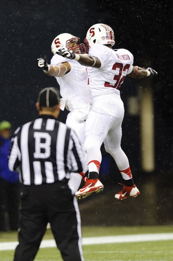 Sep 28, 2013; Seattle, WA, USA; Stanford Cardinal wide receiver Michael Rector (3) and running back Anthony Wilkerson (32) celebrate after Rector scored a touchdown against the Washington State Cougars during the 2nd half at CenturyLink Field. Stanford defeated Washington State 55-17. Mandatory Credit: Steven Bisig-USA TODAY Sports