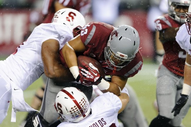 Sep 28, 2013; Seattle, WA, USA; Washington State Cougars running back Jeremiah Laufasa (43) carries the ball during the 2nd half against the Stanford Cardinal at CenturyLink Field. Stanford defeated Washington State 55-17. Mandatory Credit: Steven Bisig-USA TODAY Sports