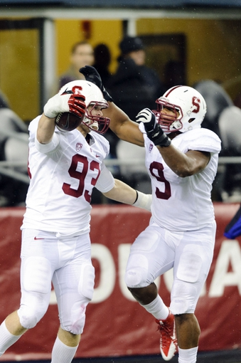 Sep 28, 2013; Seattle, WA, USA; Stanford Cardinal linebacker Trent Murphy (93) and linebacker James Vaughters (9) celebrate after Murphy intercepted and pass and scored a touchdown against the Washington State Cougars during the 2nd half at CenturyLink Field. Stanford defeated Washington State 55-17. Mandatory Credit: Steven Bisig-USA TODAY Sports