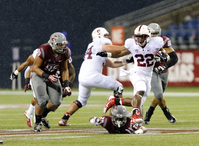 Sep 28, 2013; Seattle, WA, USA; Stanford Cardinal running back Remound Wright (22) carries the ball against the Washington State Cougars during the 2nd half at CenturyLink Field. Stanford defeated Washington State 55-17. Mandatory Credit: Steven Bisig-USA TODAY Sports