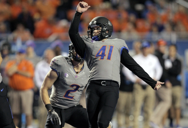 Sep 28, 2013; Boise, ID, USA; Boise State Broncos kicker Dan Goodale (41) kicks an extra point from the hold of wide receiver Matt Miller (2) during the second half against the Southern Miss Golden Eagles at Bronco Stadium. Boise State defeated Southern Miss 60-7. Mandatory Credit: Brian Losness-USA TODAY Sports