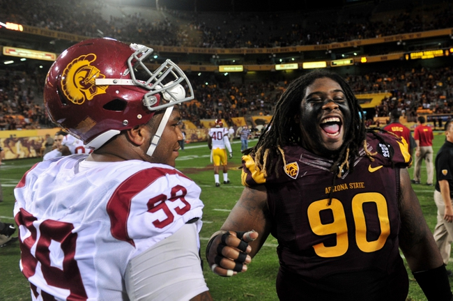 Sep 28, 2013; Tempe, AZ, USA; Arizona State Sun Devils defensive tackle Will Sutton (90) talks with USC Trojans defensive tackle Antwaun Woods (99) after the game at Sun Devil Stadium. Mandatory Credit: Matt Kartozian-USA TODAY Sports
