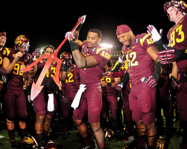 Sep 28, 2013; Tempe, AZ, USA; Arizona State Sun Devils wide receiver Jaelen Strong (21) spikes the pitchfork in celebration after beating the USC Trojans 62-41 at Sun Devil Stadium. Mandatory Credit: Matt Kartozian-USA TODAY Sports