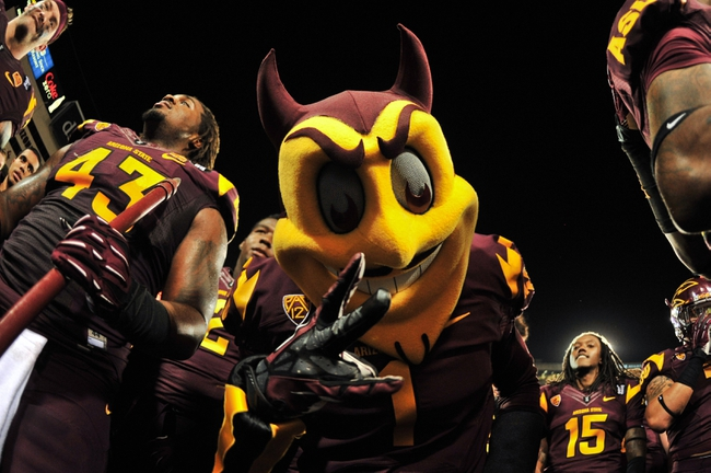 Sep 28, 2013; Tempe, AZ, USA; Arizona State Sun Devils mascot Sparky celebrates with defensive end Davon Coleman (43) after beating the USC Trojans 62-41 at Sun Devil Stadium. Mandatory Credit: Matt Kartozian-USA TODAY Sports