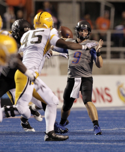Sep 28, 2013; Boise, ID, USA; Boise State Broncos quarterback Grant Hedrick (9) throws a pass down field during the second half against the Southern Miss Golden Eagles at Bronco Stadium. Boise State defeated Southern Miss 60-7. Mandatory Credit: Brian Losness-USA TODAY Sports