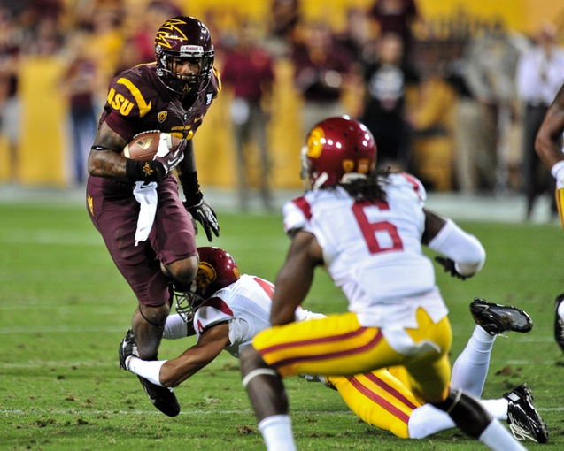 Sep 28, 2013; Tempe, AZ, USA; Arizona State Sun Devils wide receiver Jaelen Strong (21) is tackled by USC Trojans cornerback Torin Harris (4) during the second half at Sun Devil Stadium. Mandatory Credit: Matt Kartozian-USA TODAY Sports