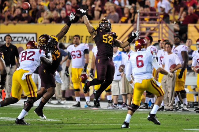 Sep 28, 2013; Tempe, AZ, USA; Arizona State Sun Devils linebacker Carl Bradford (52) jumps to try and block a pass by USC Trojans quarterback Cody Kessler (6) during the second half at Sun Devil Stadium. Mandatory Credit: Matt Kartozian-USA TODAY Sports