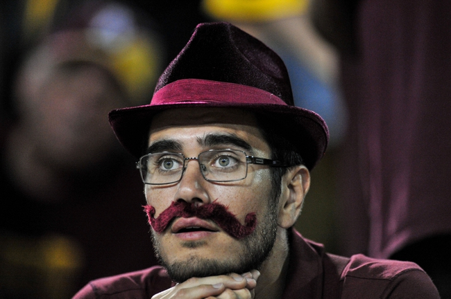 Sep 28, 2013; Tempe, AZ, USA; An Arizona State Sun Devils fan looks on during the second half against the USC Trojans at Sun Devil Stadium. Mandatory Credit: Matt Kartozian-USA TODAY Sports