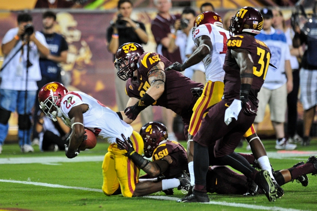 Sep 28, 2013; Tempe, AZ, USA; USC Trojans running back Justin Davis (22) scores a 15 yar touchdown while being tackled by Arizona State Sun Devils safety Alden Darby (4) during the second half at Sun Devil Stadium. Mandatory Credit: Matt Kartozian-USA TODAY Sports
