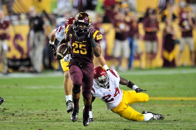 Sep 28, 2013; Tempe, AZ, USA; Arizona State Sun Devils running back Deantre Lewis (25) runs 45 yards for a first down as USC Trojans safety Demetrius Wright (24) pursues during the second half at Sun Devil Stadium. Mandatory Credit: Matt Kartozian-USA TODAY Sports