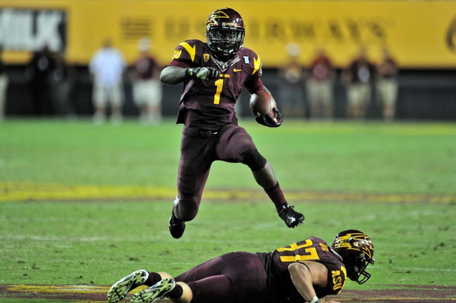 Sep 28, 2013; Tempe, AZ, USA; Arizona State Sun Devils running back Marion Grice (1) hurdles tight end Chris Coyle (87) en route to a 28 yard touchdown during the second half against the USC Trojans at Sun Devil Stadium. Mandatory Credit: Matt Kartozian-USA TODAY Sports
