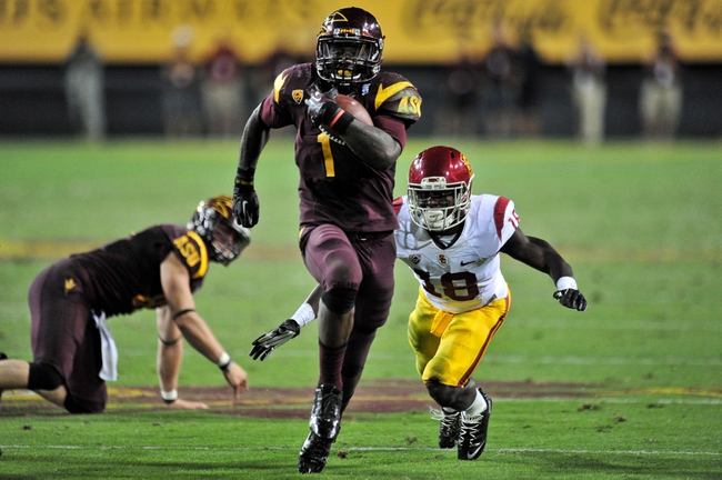 Sep 28, 2013; Tempe, AZ, USA; Arizona State Sun Devils running back Marion Grice (1) runs for a 28 yard touchdown while USC Trojans safety Dion Bailey (18) pursues during the second half at Sun Devil Stadium. Mandatory Credit: Matt Kartozian-USA TODAY Sports