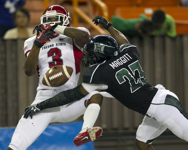Sep 28, 2013; Honolulu, HI, USA;  Fresno State wide receiver Josh Harper (3) cannot pull in a catch while being guarded by Hawaii cornerback Dee Maggitt (23) during the third quarter of the NCAA college football game at Aloha Stadium. Mandatory Credit: Marco Garcia-USA TODAY Sports