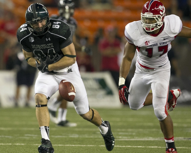 Sep 28, 2013; Honolulu, HI, USA; Hawaii tight end Clark Evans (84) cannot catch a pass while defended by Fresno State linebacker Kyrie Wilson during the fourth quarter of the NCAA college football game at Aloha Stadium. Mandatory Credit: Marco Garcia-USA TODAY Sports