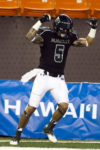 Sep 28, 2013; Honolulu, HI, USA; Hawaii wide receiver Billy Ray Stutzmann (5) celebrates after making a touchdown against Fresno State in the fourth quarter of the NCAA college football game at Aloha Stadium. Mandatory Credit: Marco Garcia-USA TODAY Sports