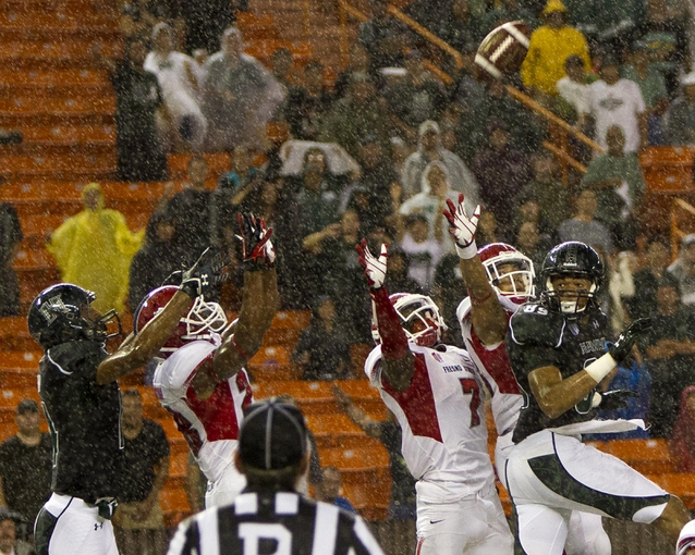 Sep 28, 2013; Honolulu, HI, USA; Hawaii players attempt to catch a hail mary pass against Fresno State in in the fourth quarter of the NCAA college football game at Aloha Stadium. Fresno State defeated Hawaii 42-37.  Mandatory Credit: Marco Garcia-USA TODAY Sports