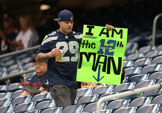Sep 29, 2013; Houston, TX, USA; Seattle Seahawks fan displays his 12th man sign prior to the game against the Houston Texans at Reliant Stadium. Mandatory Credit: Matthew Emmons-USA TODAY Sports