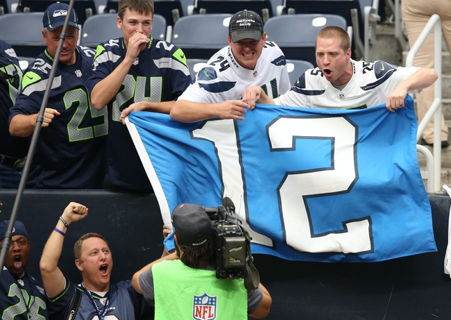 Sep 29, 2013; Houston, TX, USA; Seattle Seahawks fans cheer for a television camera prior to the game against the Houston Texans at Reliant Stadium. Mandatory Credit: Matthew Emmons-USA TODAY Sports