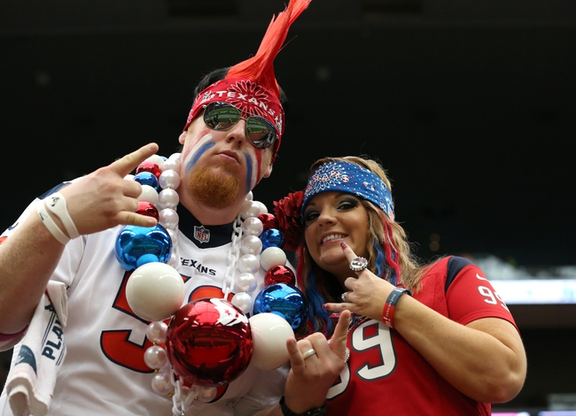 Sep 29, 2013; Houston, TX, USA; Houston Texans fans pose for a photo prior to the game against the Seattle Seahawks at Reliant Stadium. Mandatory Credit: Matthew Emmons-USA TODAY Sports