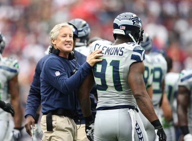 Sep 29, 2013; Houston, TX, USA; Seattle Seahawks head coach Pete Carroll celebrates a turnover on defense with defensive end Chris Clemons (91) in the first quarter against the Houston Texans at Reliant Stadium. Mandatory Credit: Matthew Emmons-USA TODAY Sports