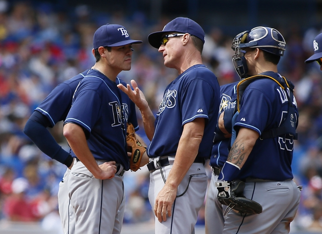 Sep 29, 2013; Toronto, Ontario, CAN; Tampa Bay Rays pitching coach Jim Hickey (center) talks to starting pitcher Matt Moore (55) during a visit to the mound in the first inning against the Toronto Blue Jays at Rogers Centre. Mandatory Credit: John E. Sokolowski-USA TODAY Sports