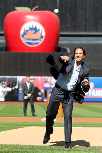Sep 29, 2013; New York, NY, USA; New York Mets former catcher Mike Piazza throws the ceremonial first pitch following his induction into the Mets Hall of Fame prior to the game against the Milwaukee Brewers at Citi Field. Mandatory Credit: Brad Penner-USA TODAY Sports
