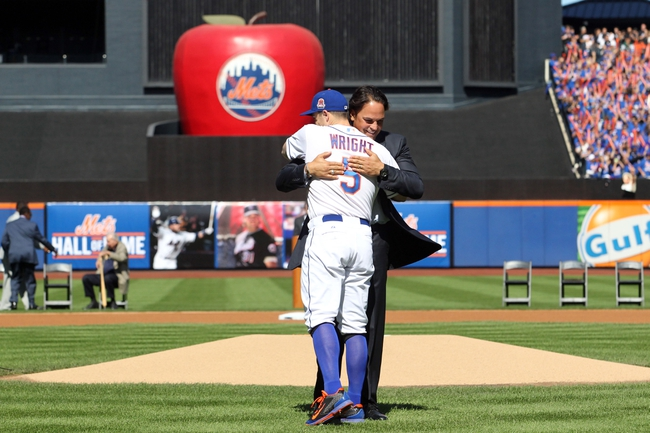 Sep 29, 2013; New York, NY, USA; New York Mets former catcher Mike Piazza hugs New York Mets third baseman David Wright (5) after throwing the ceremonial first pitch after his induction into the Mets Hall of Fame prior to the game against the Milwaukee Brewers at Citi Field. Mandatory Credit: Brad Penner-USA TODAY Sports