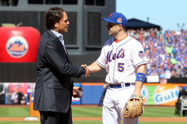 Sep 29, 2013; New York, NY, USA; New York Mets former catcher Mike Piazza shakes hands with New York Mets third baseman David Wright (5) after throwing the ceremonial first pitch after his induction into the Mets Hall of Fame prior to the game against the Milwaukee Brewers at Citi Field. Mandatory Credit: Brad Penner-USA TODAY Sports