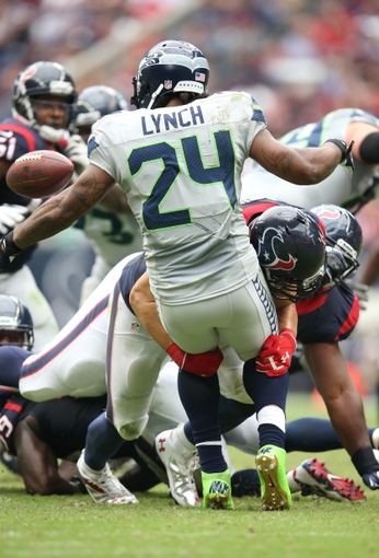 Sep 29, 2013; Houston, TX, USA; Houston Texans linebacker Brian Cushing (56) causes a fumble on a tackle against Seattle Seahawks running back Marshawn Lynch (24) in the second quarter at Reliant Stadium. Mandatory Credit: Matthew Emmons-USA TODAY Sports