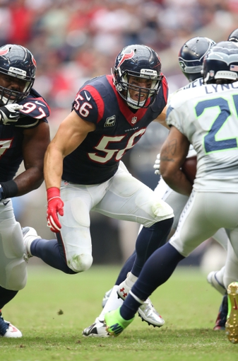 Sep 29, 2013; Houston, TX, USA; Houston Texans linebacker Brian Cushing (56) prepares to tackle Seattle Seahawks running back Marshawn Lynch (24) in the second quarter at Reliant Stadium. Mandatory Credit: Matthew Emmons-USA TODAY Sports