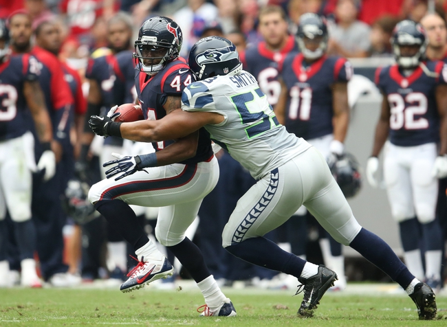 Sep 29, 2013; Houston, TX, USA; Houston Texans running back Ben Tate (44) runs with the ball against Seattle Seahawks linebacker Malcolm Smith (53) in the second quarter at Reliant Stadium. Mandatory Credit: Matthew Emmons-USA TODAY Sports