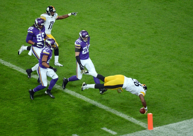Sep 29, 2013; London, UNITED KINGDOM; Pittsburgh Steelers running back Le'Veon Bell (26) scores a touchdown against the Minnesota Vikings during the NFL International Series game at Wembley Stadium. Mandatory Credit: Bob Martin-USA TODAY Sports