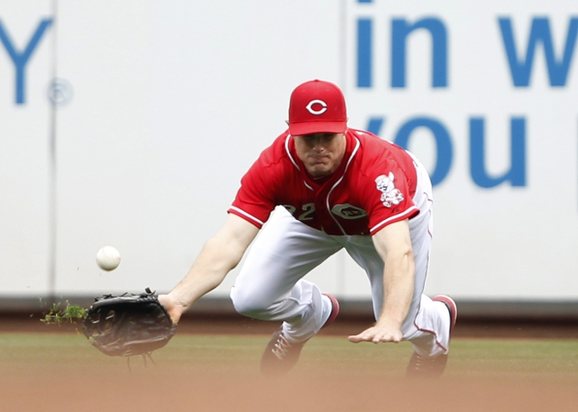 Sep 29, 2013; Cincinnati, OH, USA; Cincinnati Reds right fielder Jay Bruce (32) dives for a ball hit by the Pittsburgh Pirates shortstop Jordy Mercer (not pictured) during the second inning at Great American Ball Park. Mandatory Credit: Frank Victores-USA TODAY Sports