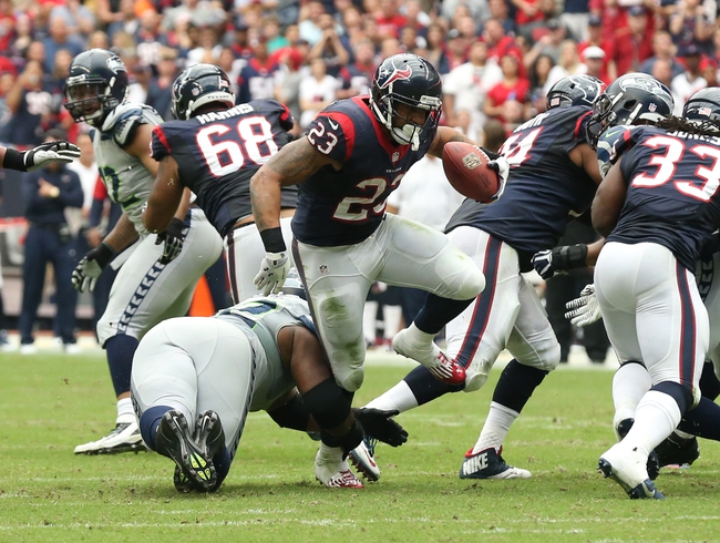 Sep 29, 2013; Houston, TX, USA; Houston Texans running back Arian Foster (23) runs with the ball against the Seattle Seahawks at Reliant Stadium. Mandatory Credit: Matthew Emmons-USA TODAY Sports
