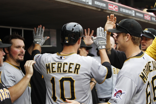 Sep 29, 2013; Cincinnati, OH, USA; Pittsburgh Pirates shortstop Jordy Mercer (10) is congratulated by team mates after hitting an inside the park home run during the second inning against the Cincinnati Reds at Great American Ball Park. Mandatory Credit: Frank Victores-USA TODAY Sports