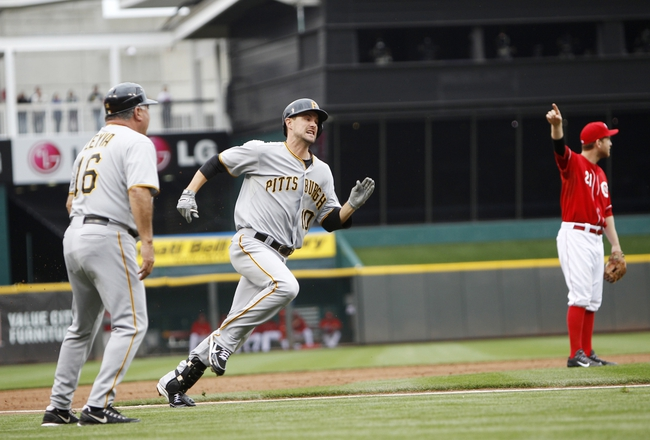 Sep 29, 2013; Cincinnati, OH, USA; Pittsburgh Pirates shortstop Jordy Mercer (10) rounds third base on his way to score on an inside the park home run during the second inning against the Cincinnati Reds at Great American Ball Park. Mandatory Credit: Frank Victores-USA TODAY Sports