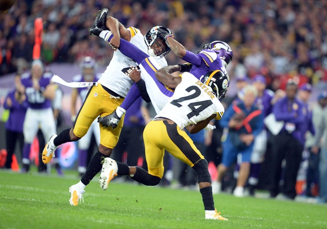 Sep 29, 2013; London, UNITED KINGDOM; Minnesota Vikings wide receiver Jerome Simpson (81) is tackled by Pittsburgh Steelers cornerback Ike Taylor (24) and free safety Ryan Clark (25) during the NFL International Series game at Wembley Stadium. Mandatory Credit: Bob Martin-USA TODAY Sports