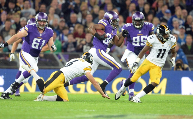 Sep 29, 2013; London, UNITED KINGDOM; Minnesota Vikings wide receiver Cordarrelle Patterson (84) returns a kick past Pittsburgh Steelers kicker Shaun Suisham (6) during the NFL International Series game at Wembley Stadium. Mandatory Credit: Bob Martin-USA TODAY Sports