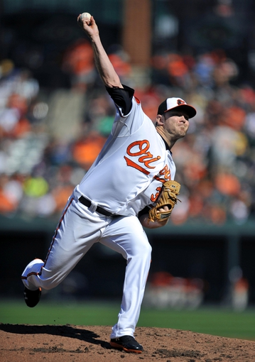 Sep 29, 2013; Baltimore, MD, USA; Baltimore Orioles starting pitcher Chris Tillman (30) throws in the second inning against the Boston Red Sox at Oriole Park at Camden Yards. Mandatory Credit: Joy R. Absalon-USA TODAY Sports