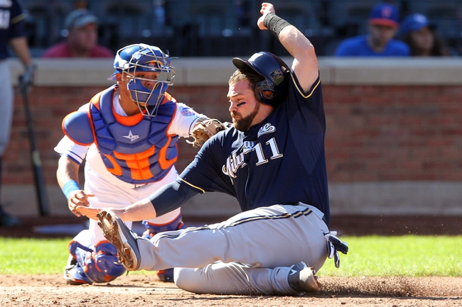 Sep 29, 2013; New York, NY, USA; Milwaukee Brewers first baseman Sean Halton (11) is tagged out at home plate by New York Mets catcher Juan Centeno (36) during the fourth inning of a game at Citi Field. Mandatory Credit: Brad Penner-USA TODAY Sports