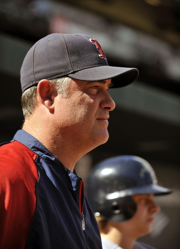 Sep 29, 2013; Baltimore, MD, USA; Boston Red Sox manager John Farrell (53) in the dugout during a game against the Baltimore Orioles at Oriole Park at Camden Yards. Mandatory Credit: Joy R. Absalon-USA TODAY Sports