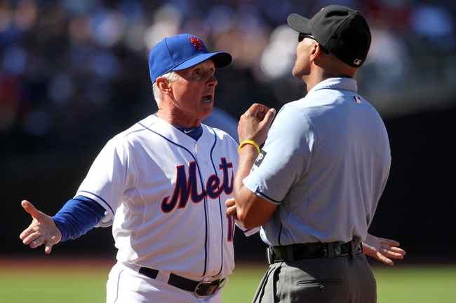 Sep 29, 2013; New York, NY, USA; New York Mets manager Terry Collins (10) argues a call with first base umpire CB Bucknor during the fourth inning of a game against the Milwaukee Brewers at Citi Field. Mandatory Credit: Brad Penner-USA TODAY Sports