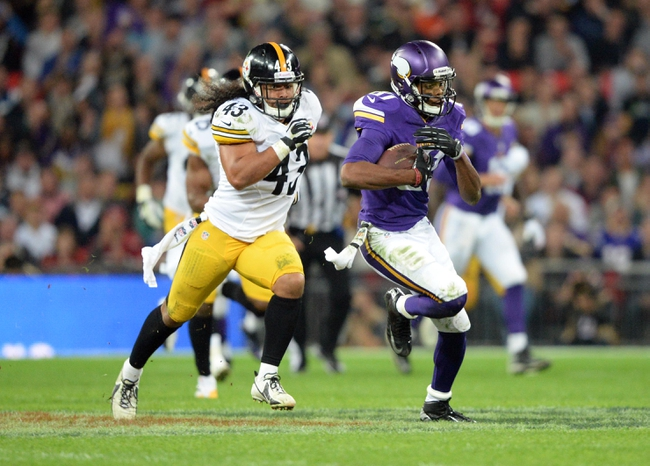 Sep 29, 2013; London, UNITED KINGDOM; Minnesota Vikings wide receiver Jerome Simpson (81) runs past Pittsburgh Steelers strong safety Troy Polamalu (43) during the NFL International Series game at Wembley Stadium. Mandatory Credit: Bob Martin-USA TODAY Sports