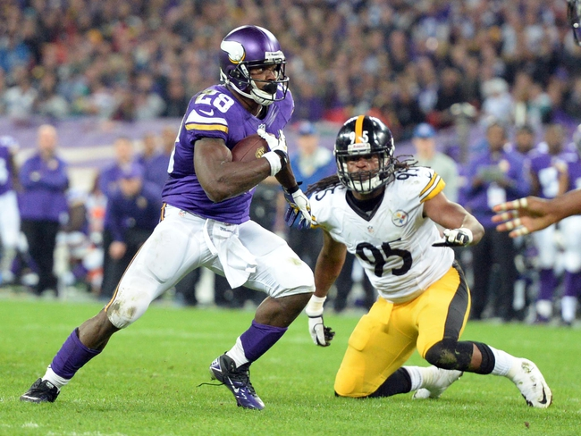 Sep 29, 2013; London, UNITED KINGDOM; Minnesota Vikings running back Adrian Peterson (28) runs past Pittsburgh Steelers outside linebacker Jarvis Jones (95) during the NFL International Series game at Wembley Stadium. Mandatory Credit: Bob Martin-USA TODAY Sports