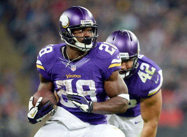 Sep 29, 2013; London, UNITED KINGDOM; Minnesota Vikings running back Adrian Peterson (28) during the NFL International Series game against the Pittsburgh Steelers at Wembley Stadium. Mandatory Credit: Bob Martin-USA TODAY Sports