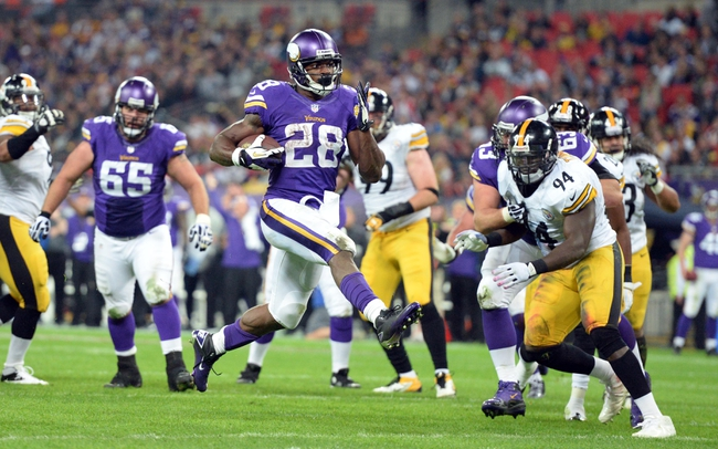 Sep 29, 2013; London, UNITED KINGDOM; Minnesota Vikings running back Adrian Peterson (28) scores a touchdown against the Pittsburgh Steelers during the NFL International Series game at Wembley Stadium. Mandatory Credit: Bob Martin-USA TODAY Sports