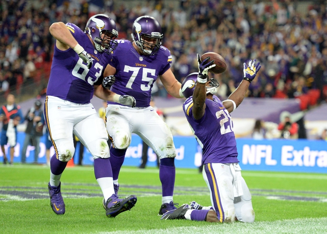 Sep 29, 2013; London, UNITED KINGDOM; Minnesota Vikings running back Adrian Peterson (28) celebrates with teammates after scoring a touchdown against the Pittsburgh Steelers during the NFL International Series game at Wembley Stadium. Mandatory Credit: Bob Martin-USA TODAY Sports