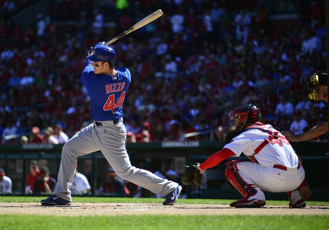 Sep 29, 2013; St. Louis, MO, USA; Chicago Cubs first baseman Anthony Rizzo (44) hits a double off of St. Louis Cardinals starting pitcher Jake Westbrook (not pictured) during the first inning at Busch Stadium. Mandatory Credit: Jeff Curry-USA TODAY Sports