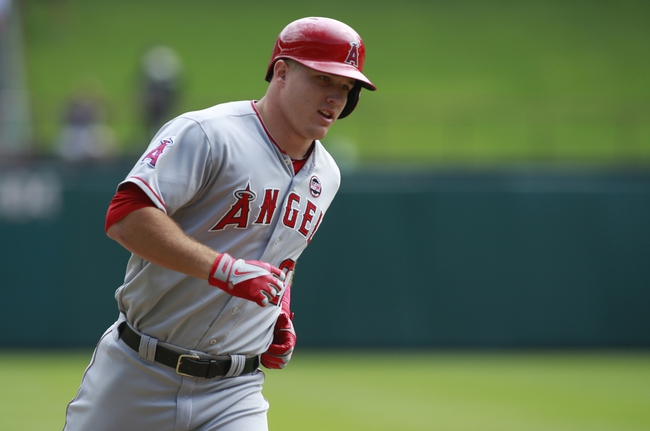Sep 29, 2013; Arlington, TX, USA; Los Angeles Angels center fielder Mike Trout (27) rounds third base after hitting a home run against the Texas Rangers at Rangers Ballpark in Arlington. Mandatory Credit: Tim Heitman-USA TODAY Sports